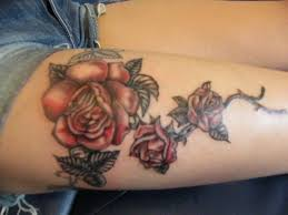 tattoos of roses in vine black and red rose tattoo by lozzrc on