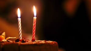 birthday cake candles happy birthday cake with burning spiral candles which are then