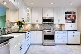 cool kitchen backsplash white cabinets black countertop istock