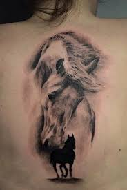 tattoo pictures horse black silhouette horse and realistic horse tattoo on girl upper back