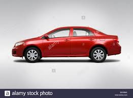 toyota 2010 2010 toyota corolla le in red drivers side profile stock photo