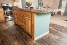 should your kitchen island match your cabinets colony homes tl820a timberland ranch kitchen island hickory