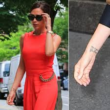 the tattoo on victoria beckham u0027s left wrist reportedly says