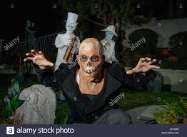 halloween spirit masks wearing a monster fright mask a young man gets into the spirit of
