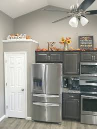 how to decorate above kitchen cabinets for fall above cabinet fall decor fall decorations kitchen fall