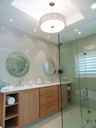 photos hgtv wood vanity with white marble countertops and mirror