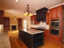 kitchen dark kitchen island with laminate wood flooring and two