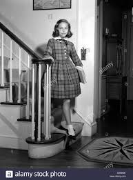 1950s teenage in plaid dress and white ankle socks standing