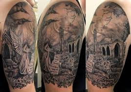 grey ink and graveyard on right half sleeve