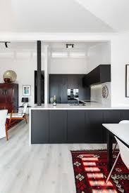 white kitchen cupboards black bench 25 black kitchen cabinets that are not dull