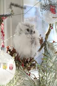 simple christmas decorating ideas in the kitchen debbiedoos wintery owl wreath in the kitchen window