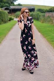 a butterfly print maxi dress with black lace up heels not