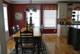 kitchen dining table and chairs plus a chandelier in the kitchen