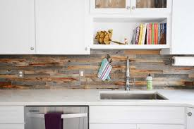 reclaimed wood backsplash tiles for kitchens bathrooms close up the everitt schilling rawhide flats series in nokomis pattern shown with
