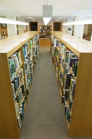 file bookshelves with books in library jpg wikimedia commons