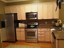 appealing light brown painted kitchen cabinets exposed brick wall