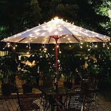 Patio Umbrellas With Led Lights String Lights On The Patio Umbrella So Easy And Pretty House