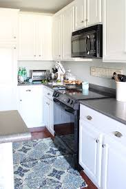 how to paint cabinets with benjamin advance painted kitchen cabinets 2 years later the turquoise home