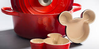 le creuset beauty and the beast this limited edition mickey mouse cookware brings the magic to