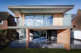 modern home exterior with glass fence decoration and flat roof