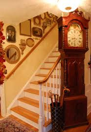decorate staircases with vintage photos mirrors and small wall