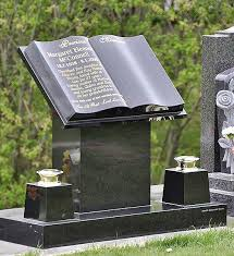 gravestone prices cemetery headstone tombstone that resembles an open book on a