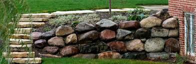 retaining wall with glacial granite boulders green stone company