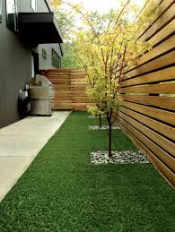 enticing small backyard landscape with wooden fence and green lawn