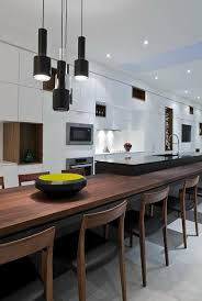 wonderful modern open kitchen design with pendant lamps above long