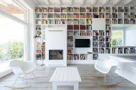 minimalist house with a long wall of books idesignarch