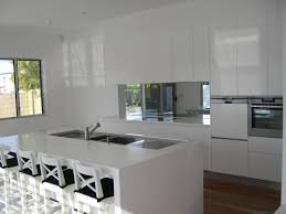 Kitchen No Backsplash by Mirror Splashback Kitchen With White Push Open Doors No Handles