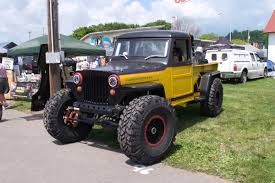 jeep willys truck lifted deegan and gibson exhaust show case style at event