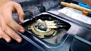 cutting fuel pump access panel and removing fuel pump assembly