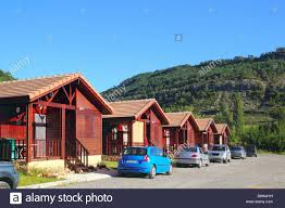 wooden bungalow houses in camping area in pyrenees mountains stock