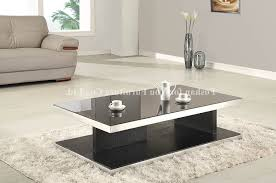 how to decorate a round coffee table living room coffee table modern white stone sleek style vases red