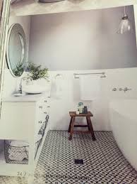 dulux tranquil retreat for walls and classic black white tiles and