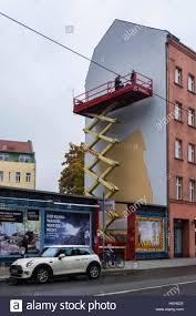 artist on scissor lift painting full wall mural advertisement artist on scissor lift painting full wall mural advertisement berlin