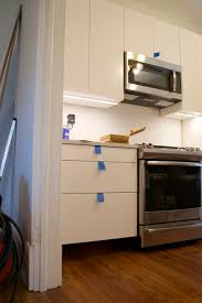 ikea kitchen wall oven cabinet tips for installing ikea cabinet lighting the white