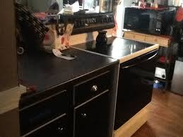 covering cabinets with contact paper used black contact paper to cover ugly old cabinets my style