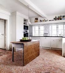 kitchen with red brick floors and white cabinets brick floor
