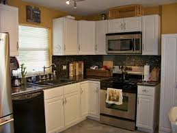 small kitchen design with white l shaped kitchen cabinet and grey