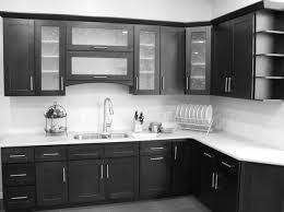 black wooden kitchen cabinet with storage and shelves combined with
