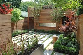 cool backyard design with untreated wooden wall and black stained