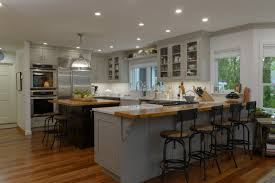 a kitchen with a view new hampshire home september october 2017 the open concept kitchen designed by homeowner and interior designer margery thomas mueller combines elegance and functionality