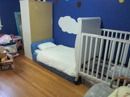 bedroom entrancing cool kid beds design with gray wooden toddler bedroom entrancing cool kid beds design with gray wooden toddler bed frame near armchair and cream wooden cupboard on the brown wooden floor also blue