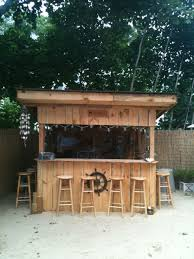 wooden backyard bar with backless stools relaxing outdoor