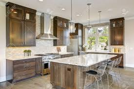 white kitchen cabinets with taupe backsplash luxury kitchen accented with large granite kitchen island taupe