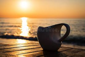 Sunrise Sunset Table Cup Of Coffee On Wood Table At Sunset Or Sunrise Beach Stock Photo