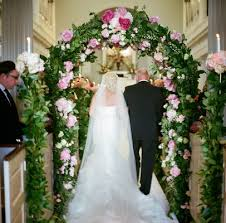 wedding arches inside pink and white destination wedding in charleston south carolina