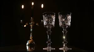 beautiful wine glasses red wine poured in a glass red wine bottle two wine glasses burning